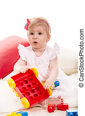 Baby girl playing with cubes