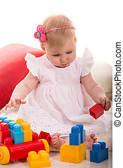 Baby girl playing with cubes toys