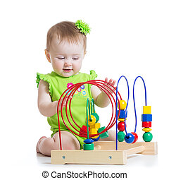 baby girl playing with educational toy - toddler girl...