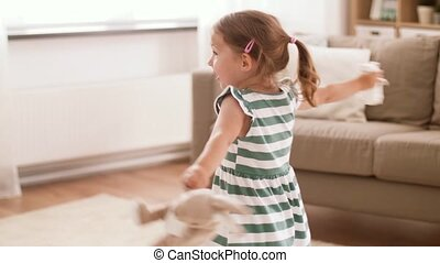 baby girl playing with soft toy rabbit and mouse - childhood...