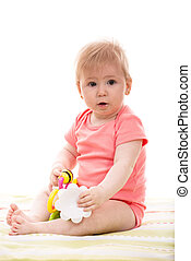 Baby girl playing with toys