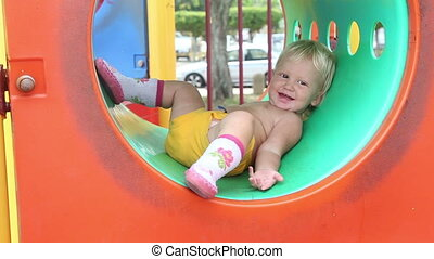 baby girl plays on the playground