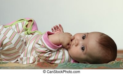 Baby Girl Plays with Fingers