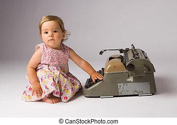 Baby Girl Posing with Typewriter