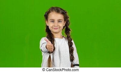 Baby girl shows thumbs up. Green screen - Baby girl showing...