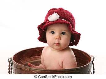Baby girl sitting in a flower pot - Adorable infant wearing...