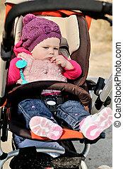 baby  girl sitting in stroller