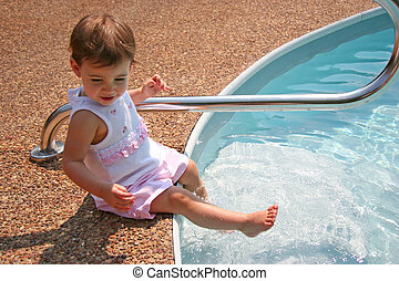 Baby Girl Splashing - Beautiful baby girl splashing water in...