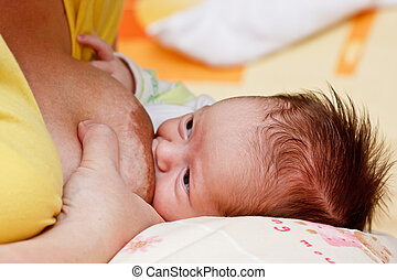 Baby girl sucking at her mother's breast - Adorable baby...