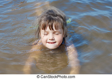 Baby girl swimming in the river