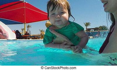 Baby girl swimming under water
