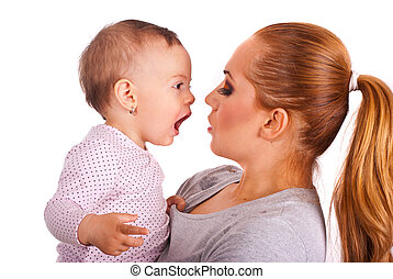 Baby girl talking with mom