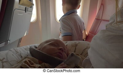 Baby girl traveling by plane with family is waking up