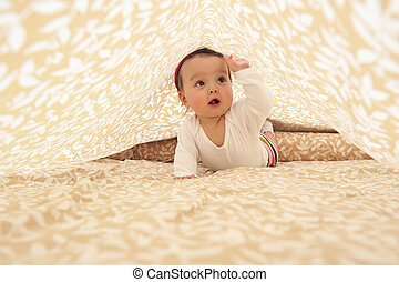 Baby girl under sheet