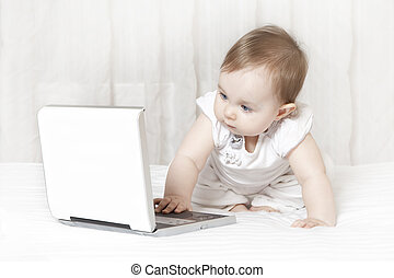 baby girl using a laptop computer