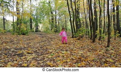 baby girl walking in autumn park
