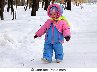baby girl walking in winter park