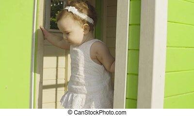 Baby girl walking on the playground
