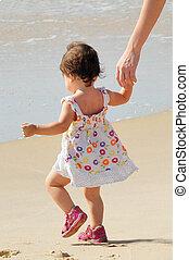 Baby Girl Walks on a Beach