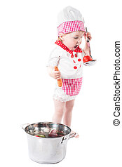 Baby girl wearing a chef hat with vegetables and pan isolated on white background.The concept of healthy food and childhood