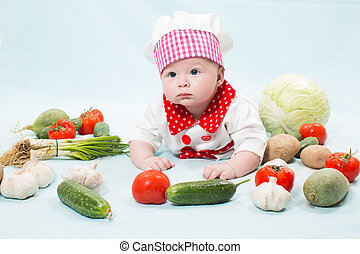 Baby girl  wearing a chef hat with vegetables. Use it for a child, healthy food concept