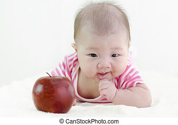 Baby girl with an apple