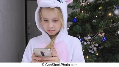 Baby girl with Christmas phone