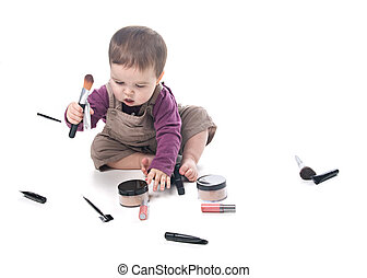 Baby girl with cosmetics