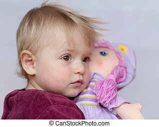 baby girl with doll