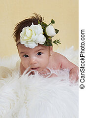 Baby girl with flower bow