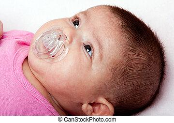 Baby girl with pacifier - Beautiful Caucasian hispanic...