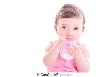 Baby girl with pink baby bottle.