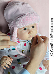 Baby girl with pink hat