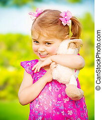Baby girl with soft toy