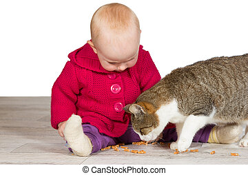 Baby girl with the family cat