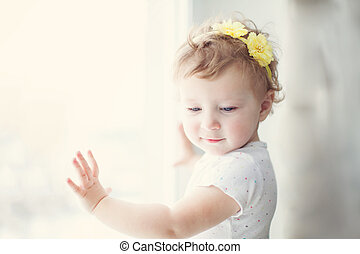 baby girl with yellow flowers in her hair