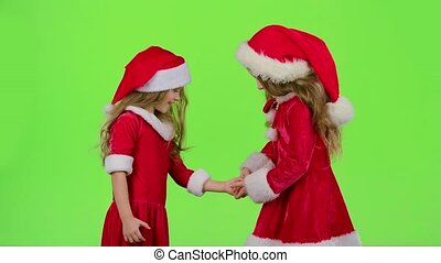 Baby girls in red suits play games, smile and have fun....