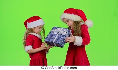 Baby gives a New Year gift to her friend. Green screen