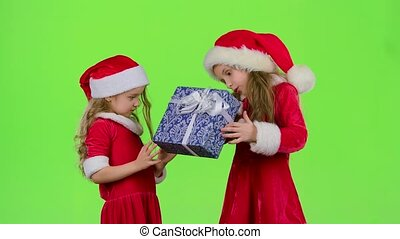 Baby gives a New Year gift to her friend. Green screen. Slow motion