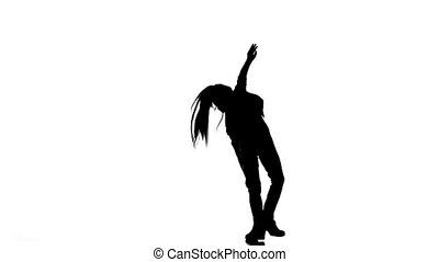 Little child does a handstand in the studio. White background. Silhouette. Slow motion