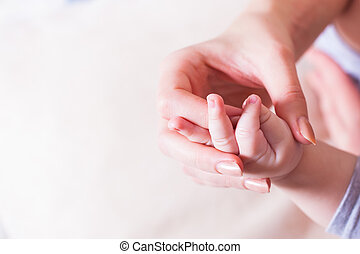 Baby hand in mother hand