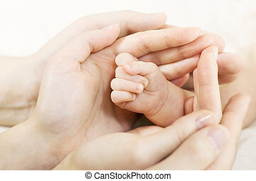 Baby hand into parents hands. Family concept - Closeup of...