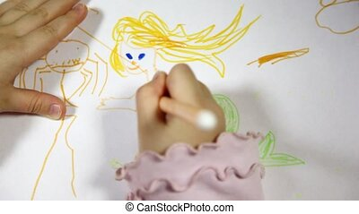 Baby hands draw pencil