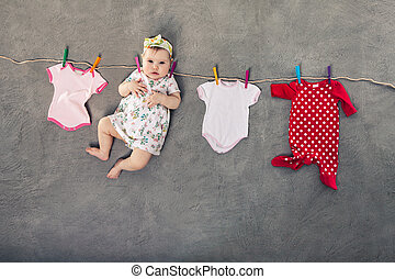 Baby hanging on the clothesline.