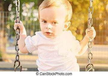 Baby having fun on a swing.