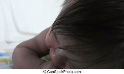 Baby Head Lifting Closeup - A sweet baby in an extreme...