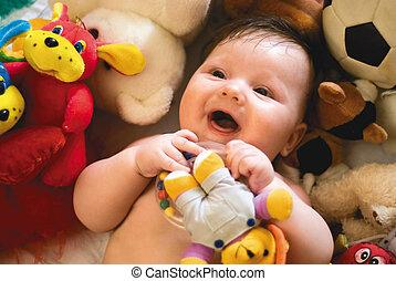 baby, het glimlachen, omringde, speelgoed