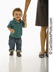 Baby holding mom\'s hand.