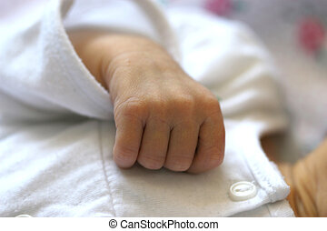Baby holding mother\'s finger
