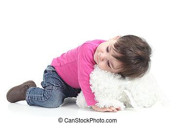 Baby hugging a teddy bear